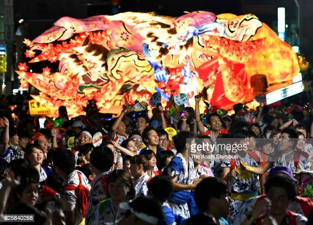 People march on with 'Nebuta' floats as the Aomori Nebuta Festival begins on August 2 2017 in Aomori Japan The festival continues until August 7