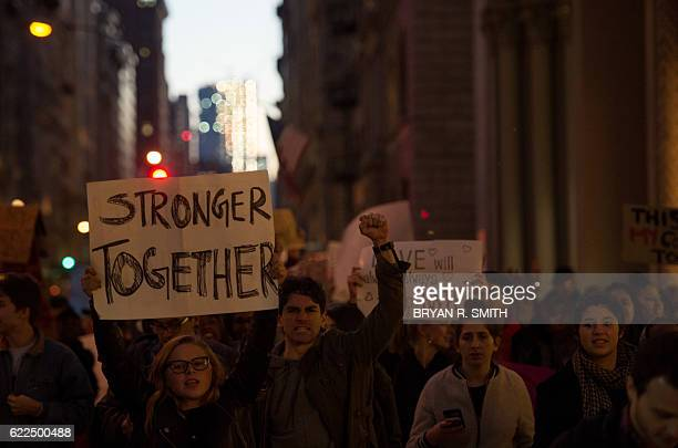 People march through Manhattan to Trump Tower during a Love Rally march in New York on November 11 to protest the election of US Presidentelect...