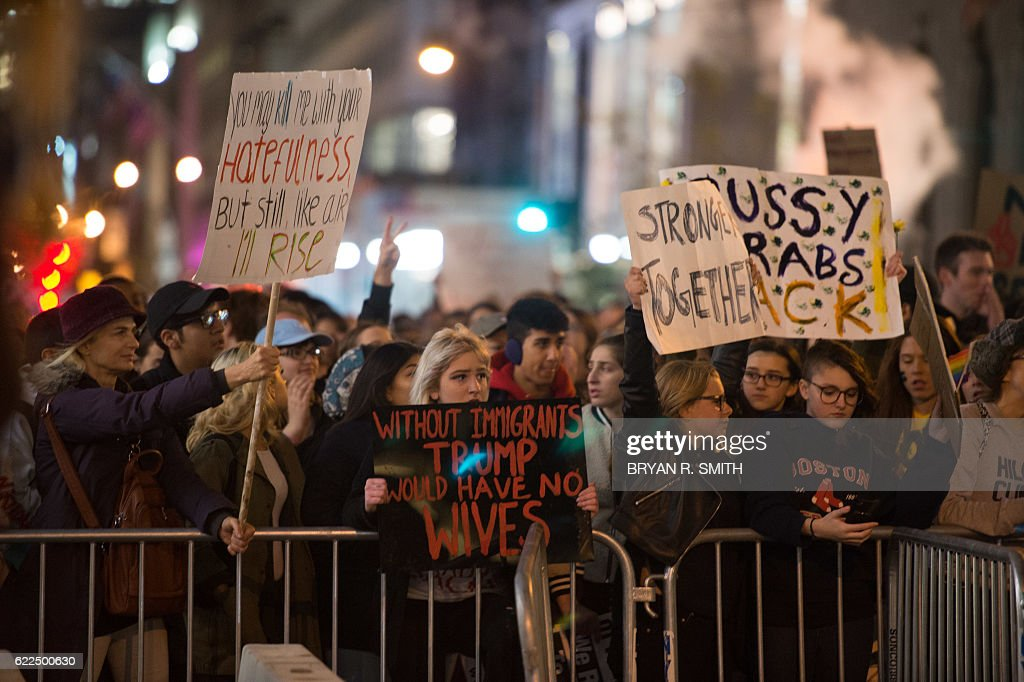 People march through Manhattan to Trump Tower during a 'Love Rally' march in New York on November 11, 2016, to protest the election of US President-elect Donald Trump. / AFP / Bryan R. Smith