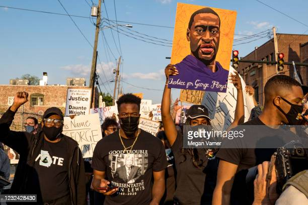 People march through the streets after the verdict was announced for Derek Chauvin on April 20, 2021 in Atlanta, United States. Former police officer...