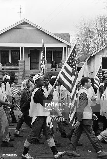 People march through the streets of Selma with Dr Martin Luther King Jr during the Selma to Montgomery Civil Rights Marches in 1965 The first march...
