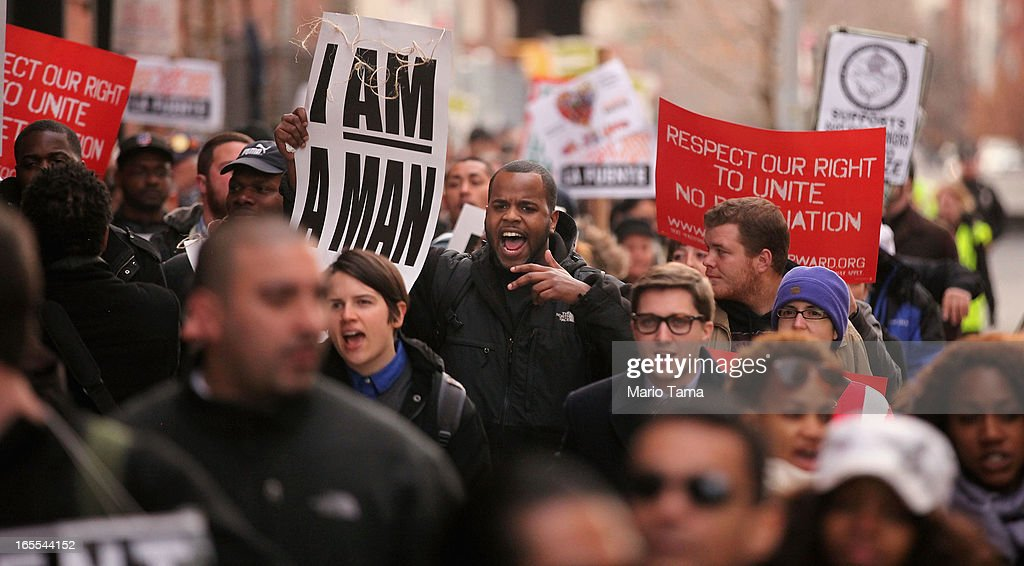 People march to a McDonald's restaurant during a protest for better wages for fast food workers in Harlem on April 4, 2013 in New York City. Organizers said hundreds of fast food workers were expected to walk off the job today from establishments including Wendy's, McDonald's and KFC to rally for better pay and union rights.