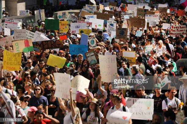People march to demand action on the global climate crisis on September 20, 2019 in New York City. In what could be the largest climate protest in...