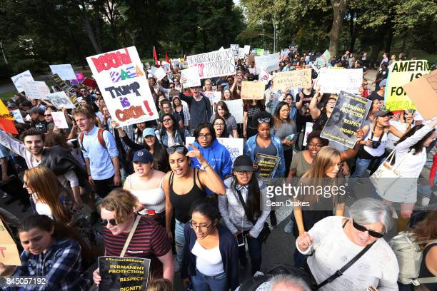 People march to protest against President Donald Trump's termination of the DACA immigration policy at Central Park on September 09 2017 in New York...