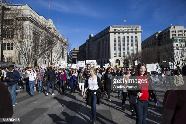People march to the front of the White House along Pennsylvania Avenue to protest President Trump and his policies in a demonstration called Not My...