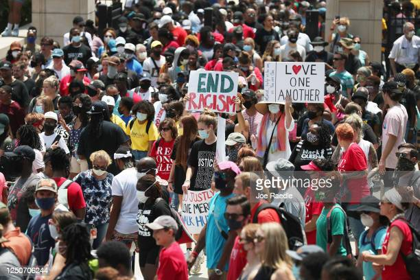 People march to the Georgia State Capitol during a Juneteenth event Organized by the One Race Movement on June 19 2020 in Atlanta Georgia Juneteenth...