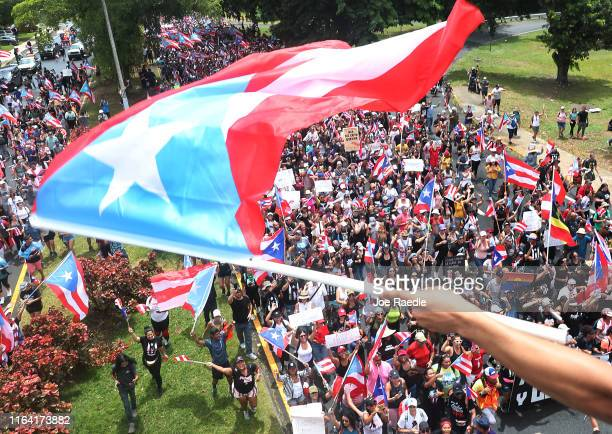 People march together as they celebrate the ouster of Ricardo Rossello, the Governor of Puerto Rico, on July 25, 2019 in Old San Juan, Puerto Rico....