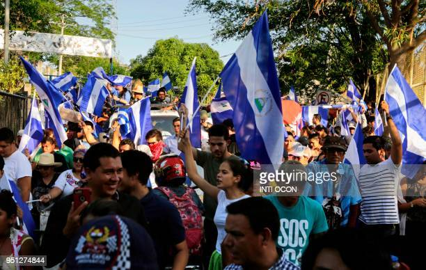People march towards El Chipote police station during a protest against the government of President Daniel Ortega in Managua on April 25 2018 A week...