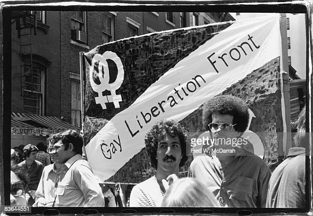 People march under a homemade Gay Liberation Front banner in the Gay Pride Day parade New York New York June 28 1970