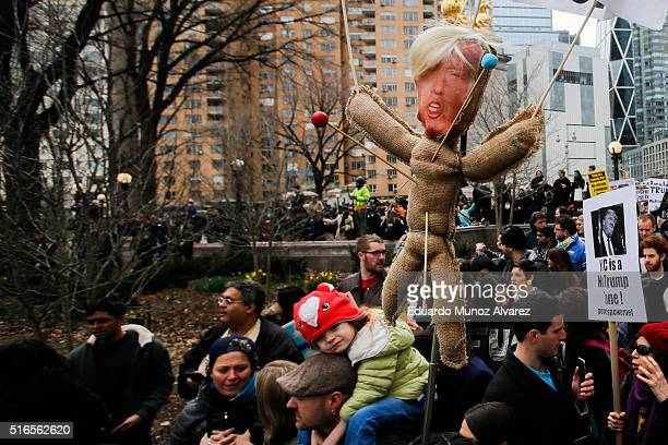 People march while they take part in a protest against Republican presidential candidate Donald Trump on March 19 2016 in New York City People...