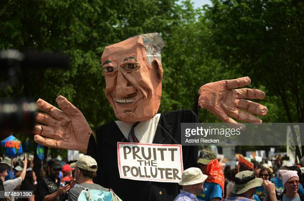 People march with a giant puppet from the US Capitol to the White House for the People's Climate Movement to protest President Donald Trump's...