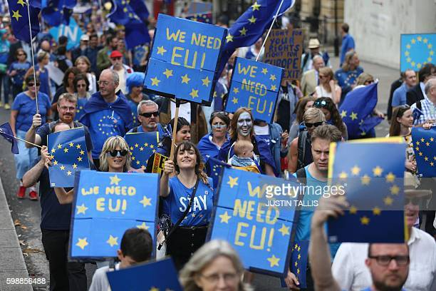 People march with EU flags and proEurope slogans on placards during a March for Europe protest against the Brexit vote in London on September 3 2016...