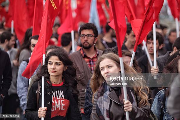 People march with flags in Istanbul's Bakirkoy district to celebrate May Day on May 1, 2016 in Istanbul, Turkey. Turkish police used tear gas and...