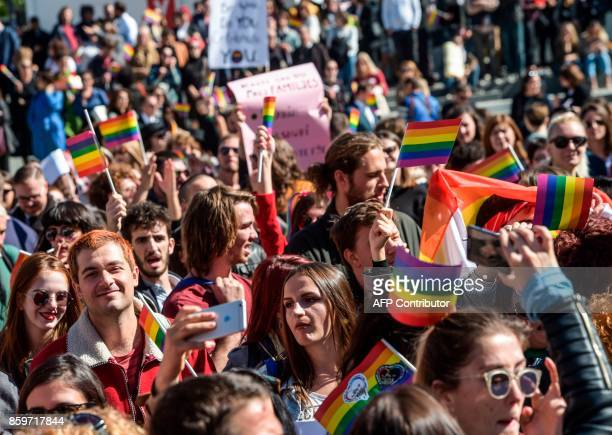 People march with LGBTI rights groups during the country's first Gay Pride parade in Pristina on October 10 2017 / AFP PHOTO / Armend NIMANI