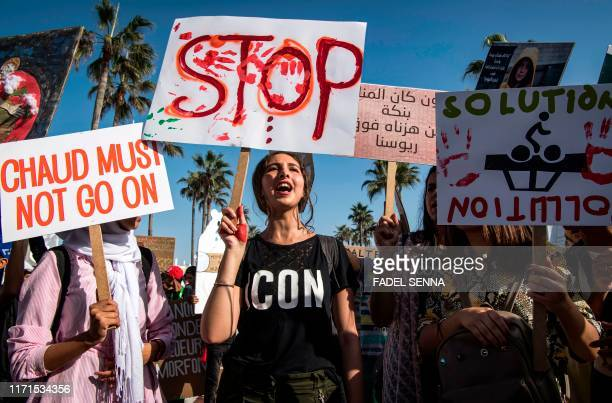 People march with protest signs during the Youth March for the Climate demonstration part of a worldwide climate strike against governmental inaction...