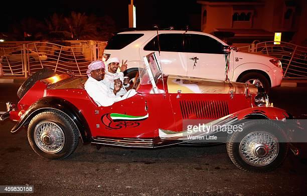 People mark the 43rd United Arab Emirates National Day with celebrations near the Burj Al Arab on December 2 2014 in Dubai United Arab Emirates