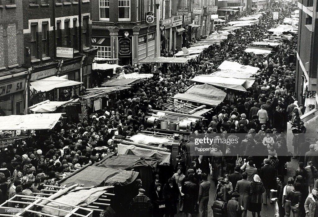 December 1976, Christmas shoppers in London's Petticoat Lane