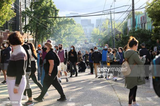 People meander in an area dubbed the Capitol Hill Autonomous Zone on June 12, 2020 in Seattle, Washington. The area had been the site of recent...