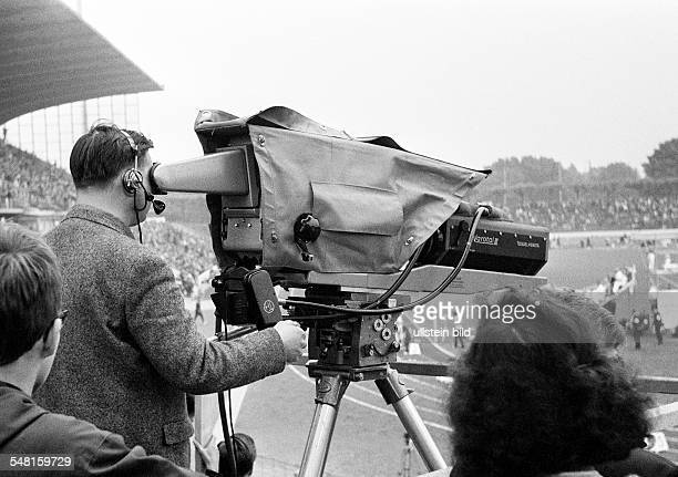people media television cameraman controlling a TV camera during a sports event in the Wedau Stadium nowadays MSV Arena German Championships in...