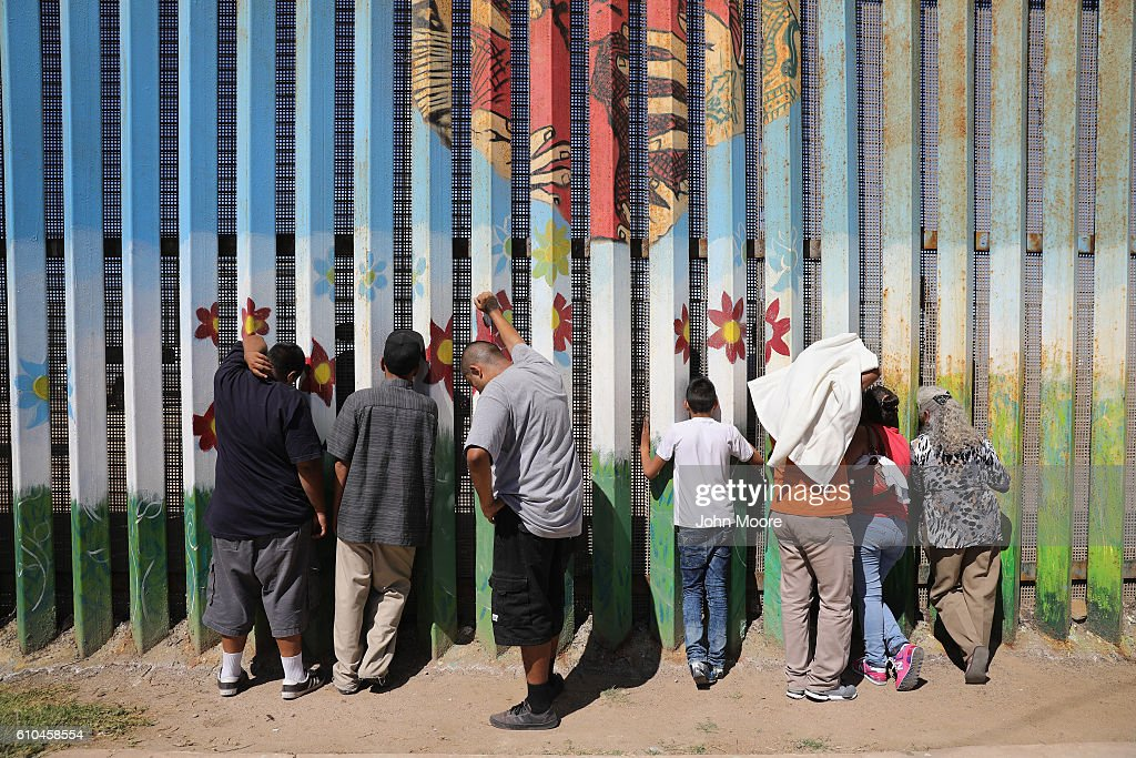 People meet loved ones through the U.S.-Mexico border fence on September 25, 2016 in Tijuana, Mexico. The U.S. Border Patrol opens the park on the American side in San Diego on weekends to meet through the fence with family and friends through the fence at Tijuana. The park is one of the few places on the 2,000-mile border where separated families are allowed to meet.