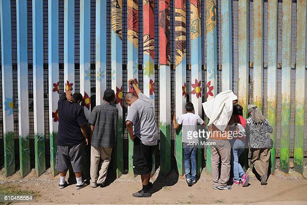 People meet loved ones through the USMexico border fence on September 25 2016 in Tijuana Mexico The US Border Patrol opens the park on the American...