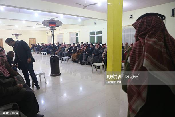 People meet with the relatives of Jordanian pilot who was captured by the Islamic State group Moadh Kasasbah during a gathering in the Kasasbah tribe...