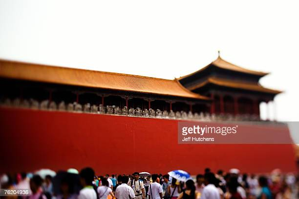 People mill about at the Forbidden City home to emperors past on June 30 2006 in Beijing China China continues to open both socially and economically...