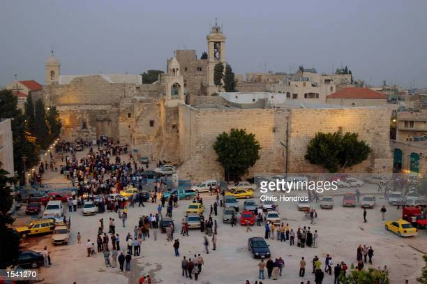 People mill about near the Church of the Nativity a standoff at the church ended May 10 2002 in the West Bank City of Bethlehem The 38day siege ended...