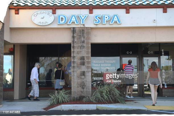 People mill around in front of the Orchids of Asia Day Spaafter New England Patriots owner Robert Kraft being charged with allegedly soliciting for...
