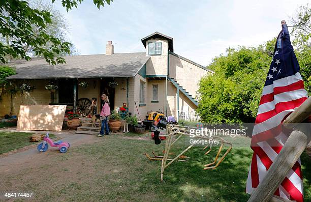 People mill around the outside of rancher Cliven Bundy ranch house on April 11 2014 west of Mesquite Nevada Bureau of Land Management officials are...