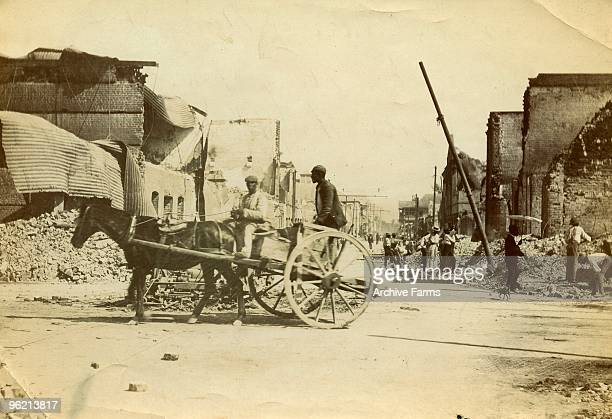 People milling about the corner of King and Harbor Streets Kingston Jamaica after the 1907 earthquake