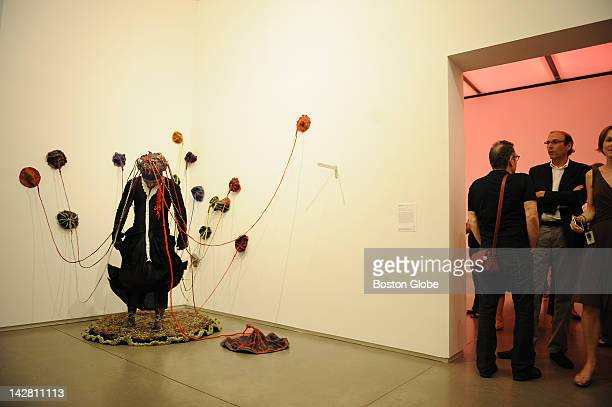 """People mingle as artist/performer Nicholas Hlobo performs his 45-minute performance """"Momentum"""" at the Institute Of Contemporary Art on July 29, 2008."""