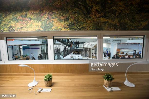 People mingle as Robert Bosch GmbH opens an Internet of Things campus in Berlin Germany on Thursday Jan 18 2018 Germanys largest union failed to make...