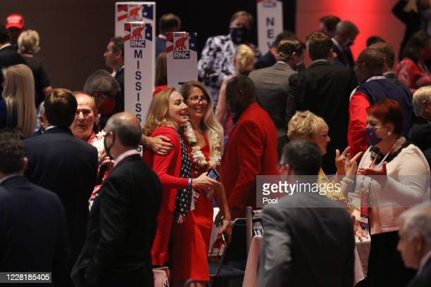 People mingle at the conclusion of President Trumps speech to delegates on the first day of the Republican National Convention at the Charlotte...