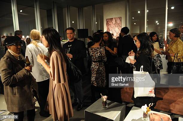 People mingle at the Vaseline and Conde Nast Media Group Skin is Amazing exhibit at The Glass House in the Chelsea Art Tower February 12 2008 in New...