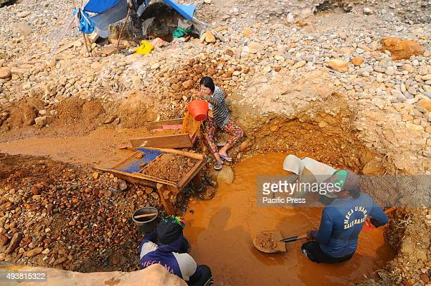 People mining gold in a traditional way at a river dam for their living The local government has appealed to the miners to stop mining activity...