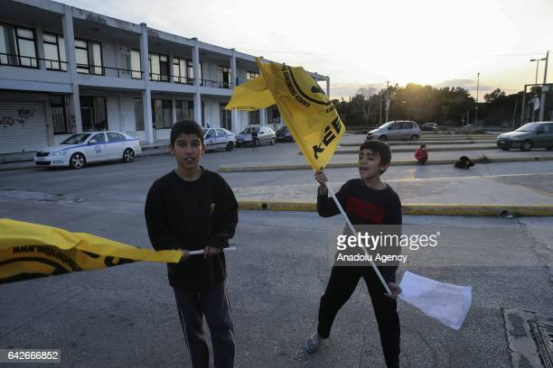 People mostly consisting refugees from Afghanistan stage a protest against poor living conditions at the refugee camp former Helinikon airport in...