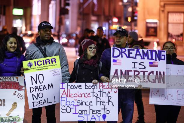 People mostly 'Dreamers' which is a group of illegal refugees' children those who live in United States hold placards during a protest demanding...