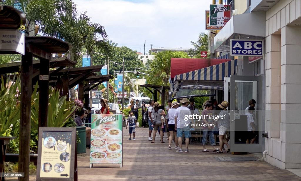 People, mostly include tourists, is seen in the streets in Tumon, Guam on August 16, 2017. With the threat of missiles from North Korea the number of tourists have dropped slightly, and while the rest of the world is uneasy, island residents continue on with their daily lives.