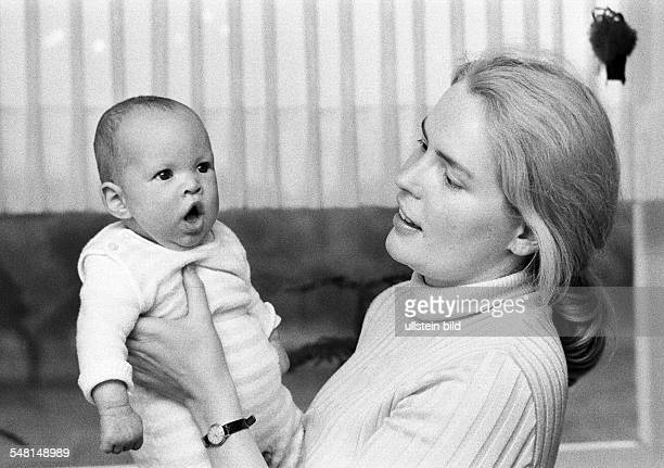 People, mother carries a baby in her arms, aged 25 to 30 years, girl, aged 1 to 3 months, Ursula, Christina -