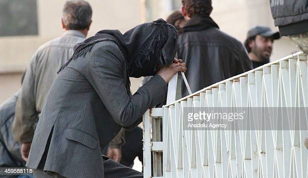 People mourn after at least 130 people have been killed in air strikes by Syrian army warplanes on the ISILheld northern city of Raqqa Syria on...