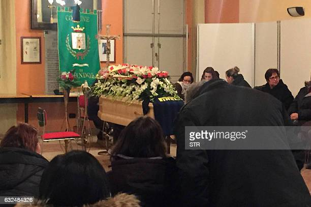 People mourn around the coffin of Alessandro Giancaterino, one of the victims of the avalanche that hit the hotel Rigopiano after an earthquake in...