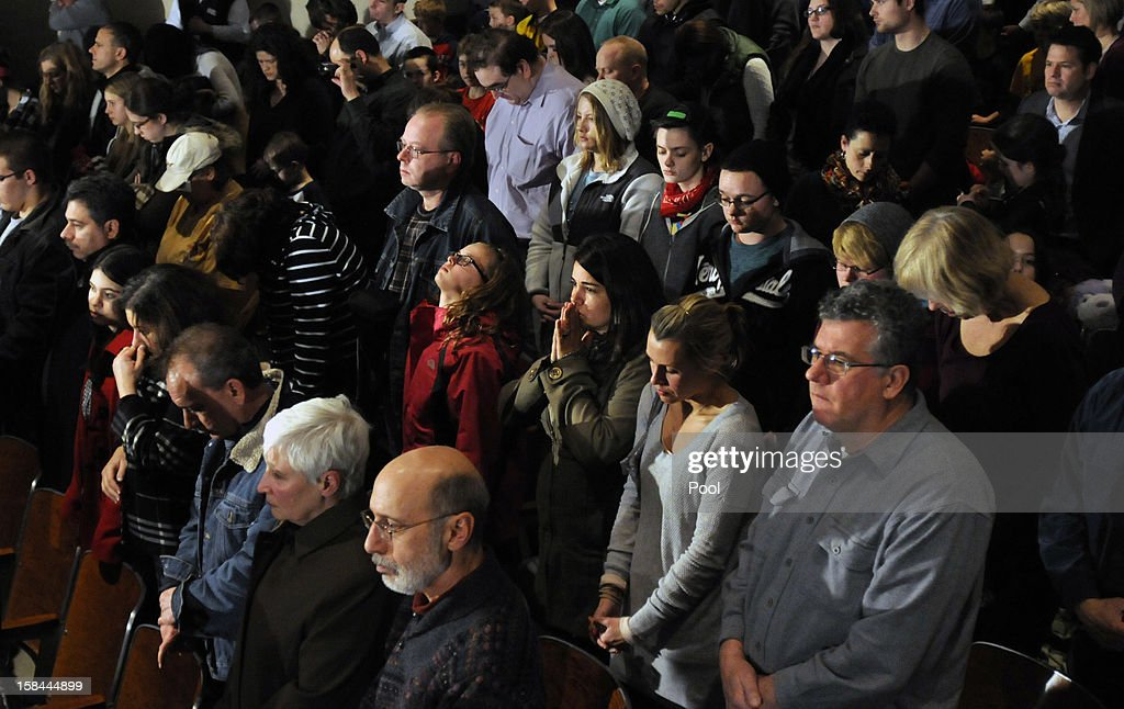 People mourn as they listen to U.S. President Barack Obama give a speech at an interfaith vigil for the shooting victims from Sandy Hook Elementary School on December 16, 2012 at Newtown High School in Newtown, Connecticut. Twenty-six people were shot dead, including twenty children, after a gunman identified as Adam Lanza opened fire at Sandy Hook Elementary School. Lanza also reportedly had committed suicide at the scene. A 28th person, believed to be Nancy Lanza, found dead in a house in town, was also believed to have been shot by Adam Lanza.