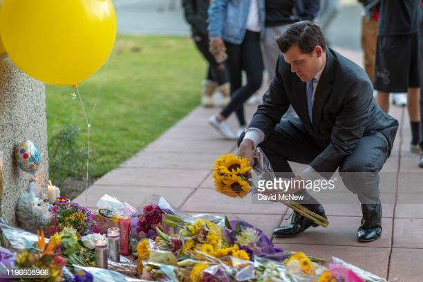 People mourn at a makeshift memorial at Mamba Sports Academy for former NBA great Kobe Bryant who was killed in a helicopter crash while commuting to...