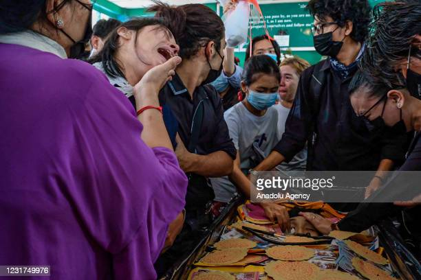 People mourn at the funeral of Khant Nyar Hein in Yangon, Myanmar on March 16 after the first year medical student was shot dead during a crackdown...