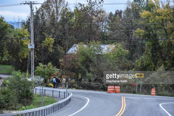 People mourn at the site of the fatal limousine crash on October 8 2018 in Schoharie New York 20 people died in the crash including the driver of the...