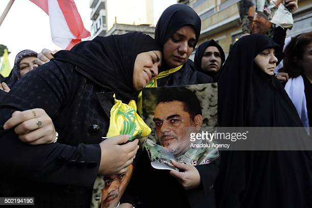 People mourn during a funeral ceremony held for Samir Kuntar, a Hezbollah military commander killed on Sunday by an airstrike -- for which the group...