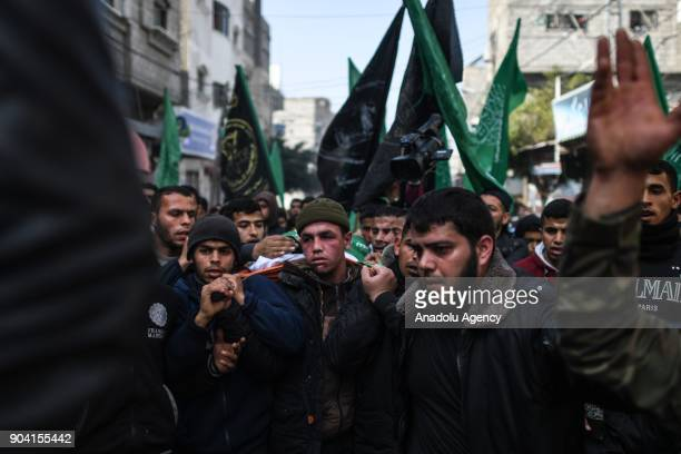 People mourn during a funeral ceremony of 16yearold Amir Abu Mosaed who was killed after being shot in the chest in clashes with the Israeli army...