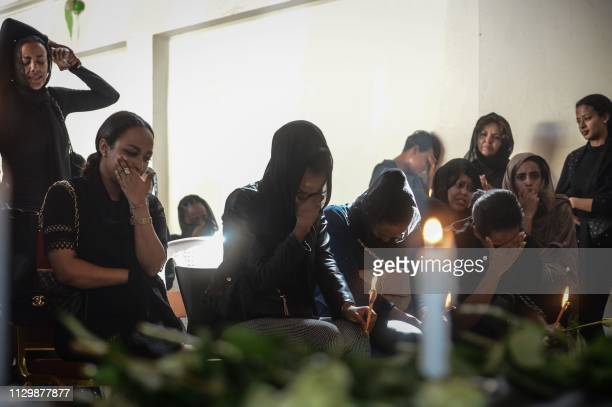 People mourn during a memorial ceremony for the seven crew members who died in the Ethiopian Airlines accident at the Ethiopian Pilot Association...