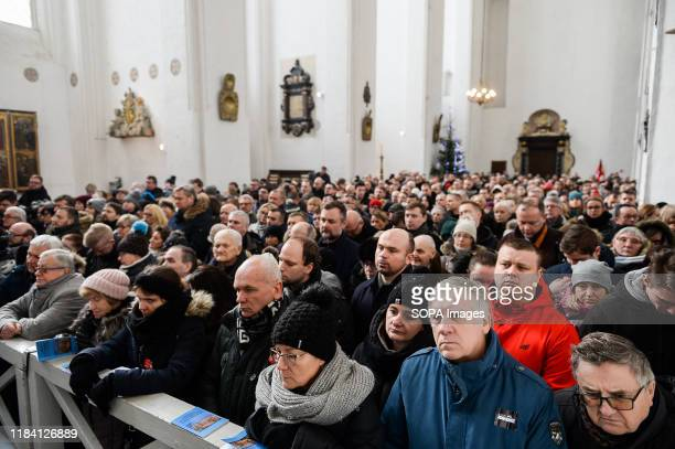 People mourn during the funeral ceremony at the Saint Mary Basilica Pawel Adamowicz Mayor of Gdansk was stabbed on stage while attending a charity...
